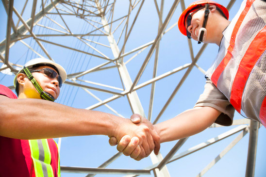 photodune-3479235-two-power-line-tower-workers-with-handshaking-xs